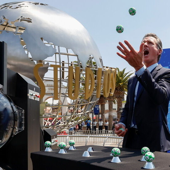 Newsom marks California's reopening with a lottery, a Hollywood robot and no mask.