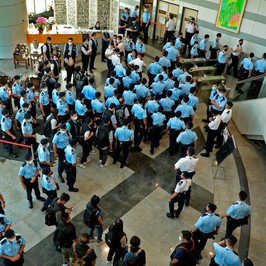 Hong Kong Police Arrest Apple Daily Executives