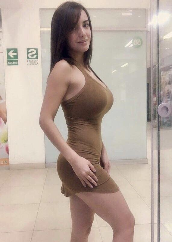 Face says shy, dress says something else
