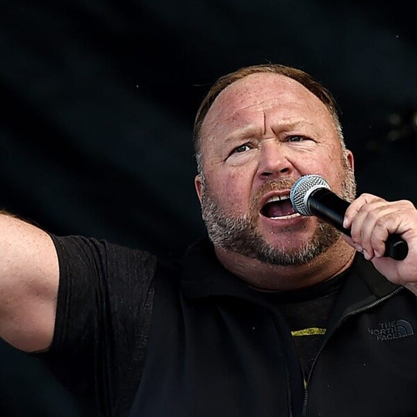 Alex Jones appears to take ivermectin during a bizarre COVID-19 rant in which he defended Joe Rogan and called Fauci a 'murderer'