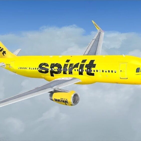 How can a passenger Upgrade Seats on Spirit Airlines?